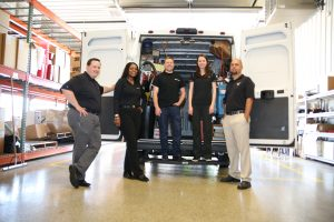 Aftermath team in front of Aftermath truck.