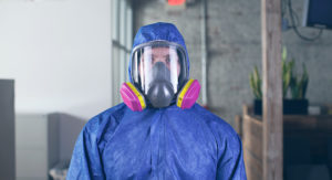 Man wearing Personal Protective Equipment, PPE.