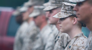 National guard men and women standing in line.