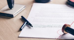 Lease agreement on desk with pen and stamp.