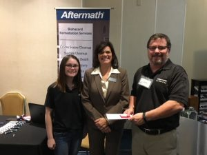 Aftermath booth and employees at Connecticut Funeral Directors Assoc. Winter Conference.
