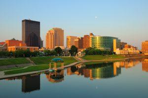 Dayton, Ohio skyline right at sunrise w/ skyline reflections on the River.