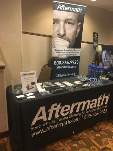Aftermath booth at Homicide Inv. of Texas Conference.