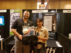 Rosa Vera Santa Ana, Coroner and Chief Investigator wins PPE kit at 2018 International Association of Coroners & Medical Examiners Conference.
