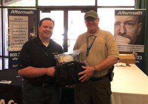 Aftermath awards Dennis Nichols a PPE kit and Tactical Bag at the 2018 ICMEA Conference