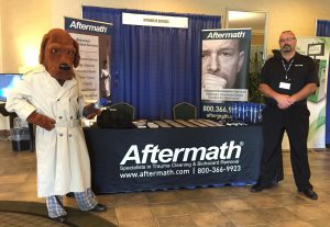 Mcgruff the Crime Dog in front of Aftermath booth at PA Conference.