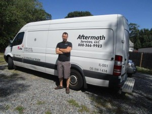 Supervisor Randy Thompson in front of Aftermath van.