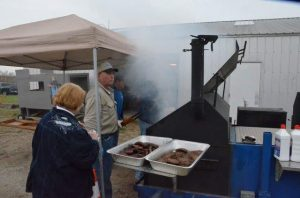 Volunteers cooking BBQ for JCSO Shootout benefiting Special Olympics.