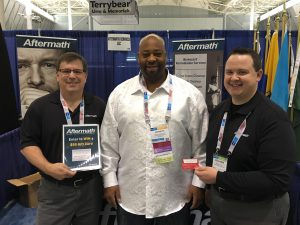National Funeral Directors Assoc. Conference winner of Aftermath giveaway standing with Ben from Aftermath.