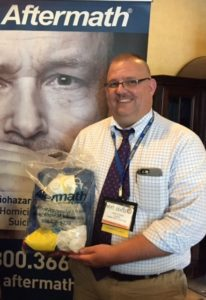 Officer poses with PPE kit at 2017 Pennsylvania Chiefs of Police Assoc. Conference.