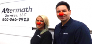 Aftermath employees wearing red noses for Red Nose Day.