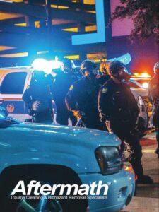 Officers wearing PPE in street