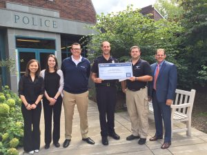 Aftermath presents check to Minnetonka PD.