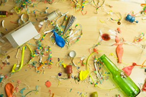 Party supplies and empty bottles littered on table.
