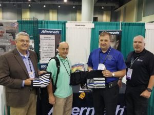 Winner of PPE kit and t-shirt at 2018 Georgia Association of Chiefs' of Police Conference.