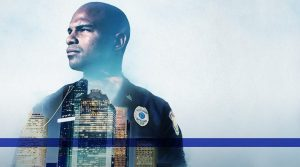 Header image of cop with city skyline in background and blue line running across the bottom.