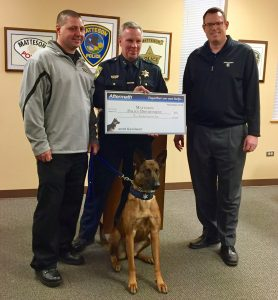 K9 Officer Jayda of the Matteson Police Department is awarded a check for $500 as part of the Aftermath K9 Grant Competition.