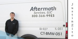 Justin Zito from Aftermath crime scene clean up in front of Aftermath van.
