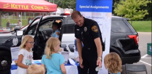 officer gives sticker to little girl