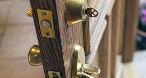 Open door with key in lock.