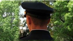 Back view of police officers head.