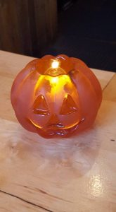 Orange pumpkin candle.